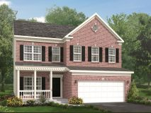 An optional brick elevation for the Richmond model home with a half porch.