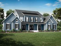 A blue modern farmhouse elevation, standard on the Kensington model, with dual double reverse gables and front porch