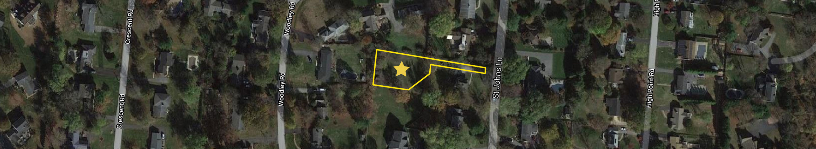 Close aerial image of 4024 Saint Johns Ln showing lot outline.