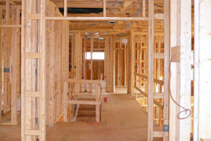 A photo taken inside a home under framing.