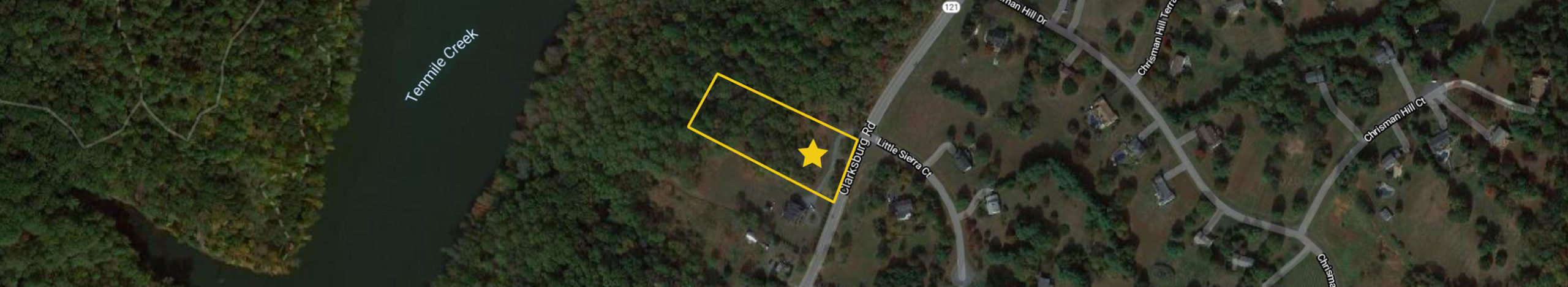 A closer aerial of 21120 Clarksburg Rd, showing Tenmile Creek and the surrounding homes and forested areas.